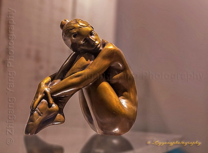 Bronze artwork ballet girl at a shop window Avignon