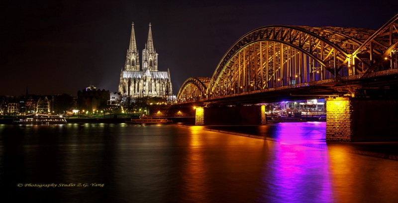 Cologne cathedral and Hohenzollern bridge by night