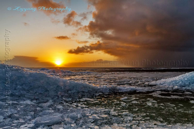 Sunset at Urk with Drifting ice ridges at lakeside