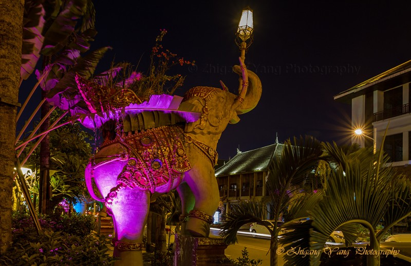 Streetlights above elephant statues
