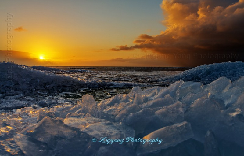 Sunset at Urk with Drifting ice at lakeside